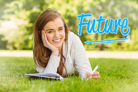 university word: The word future against smiling university student lying and writing on notepad Stock Photo