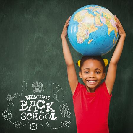 planeta tierra feliz: Pupil holding globe against green chalkboard