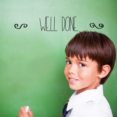 acclaim: The word well-done! against cute pupil holding chalk