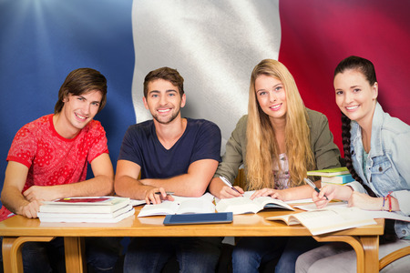 assignment: Students studying against digitally generated france national flag