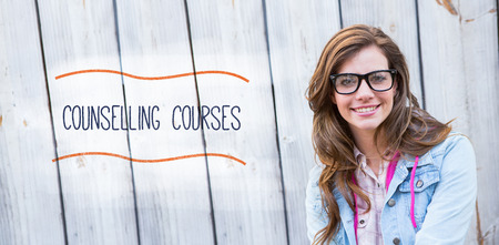 counselling: The word counselling courses against pretty woman smiling at camera