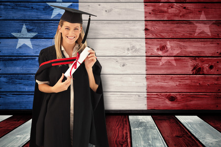 fresh graduate: Woman smiling at her graduation  against composite image of usa national flag