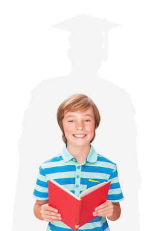 early 30s: Cute pupil smiling at camera in library  against silhouette of graduate