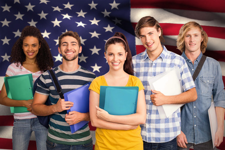 spangled: Students holding folders in college against digitally generated american national flag Stock Photo