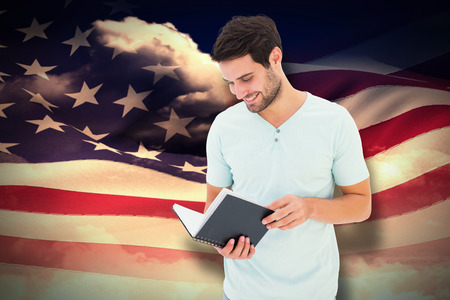 rippling: Student reading book against composite image of digitally generated american flag rippling Stock Photo