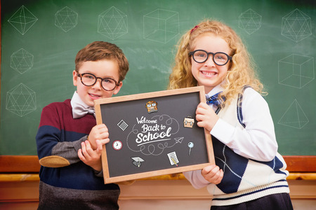 pupils: geometric shape against pupils holding blackboard