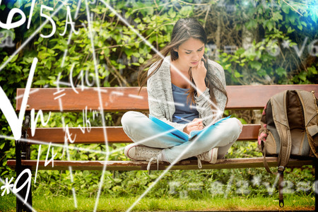 difficulty: Math problems against smiling student sitting on bench reading book Stock Photo