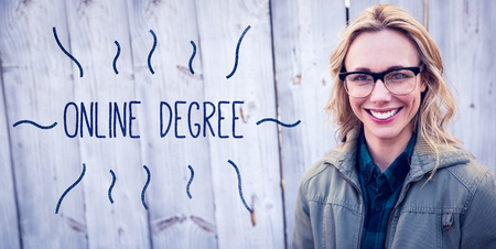 online degree: The word online degree against portrait of blonde in glasses posing