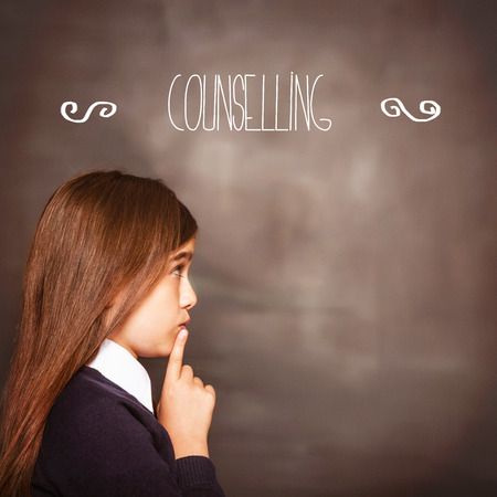counselling: The word counselling against cute pupil looking a chalkboard
