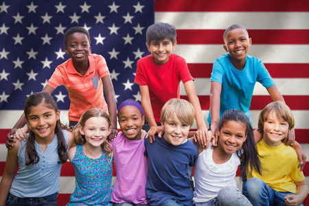 Happy friends in the park  against digitally generated american national flag Stock Photo