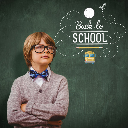 make believe: Cute pupil dressed up as teacher against green chalkboard Stock Photo