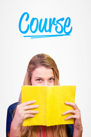covering the face: The word course and student covering face with book in library  against white background with vignette Stock Photo