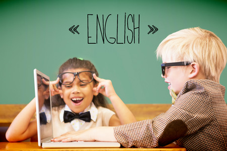 early childhood: The word english against cute pupils dressed up as teachers in classroom