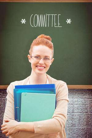 committee: The word committee and teacher with files against green Stock Photo