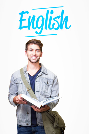 The word english and student smiling at camera in library against white background with vignette