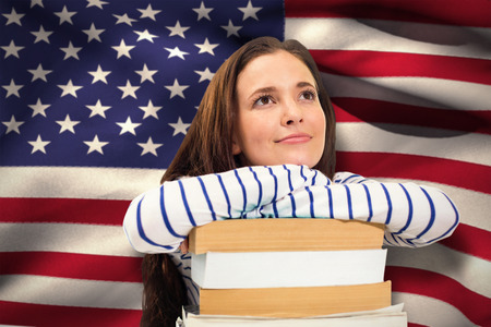 revision: Students studying against digitally generated american national flag Stock Photo