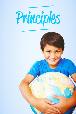 principles: The word principles and pupil holding globe against blue vignette background