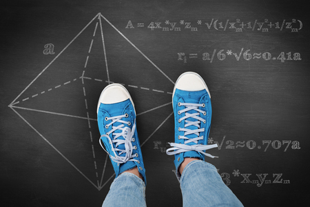 physics background: Casual shoes against black background