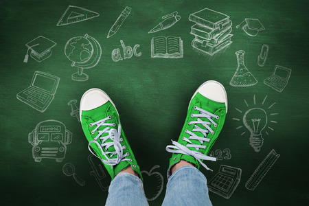 Casual shoes against green chalkboard Stock Photo