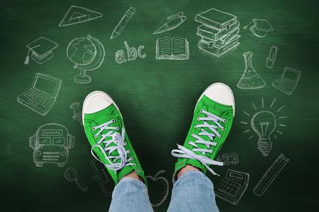 green chalkboard: Casual shoes against green chalkboard Stock Photo