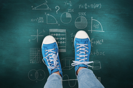 complication: Casual shoes against green chalkboard Stock Photo