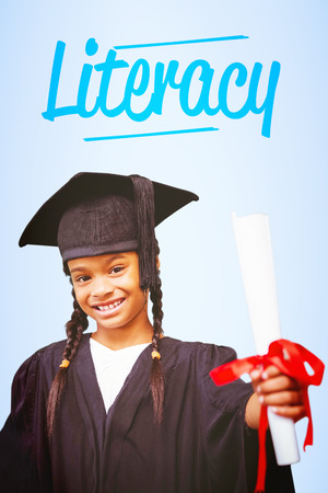 graduacion ni�os: The word literacy and cute pupil in graduation robe against blue vignette background
