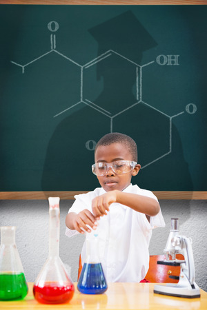 make believe: Cute pupil playing scientist against teal