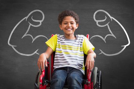 Cute disabled pupil smiling at camera in hall against black background Stockfoto
