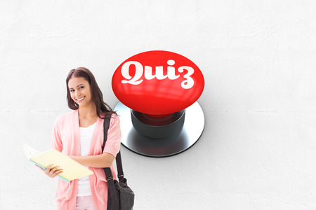 shoulder buttons: The word quiz and pretty student smiling at camera against digitally generated red push button Stock Photo