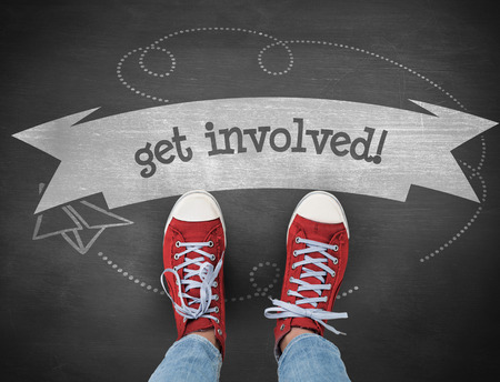 involved: The word get involved! and casual shoes against black background