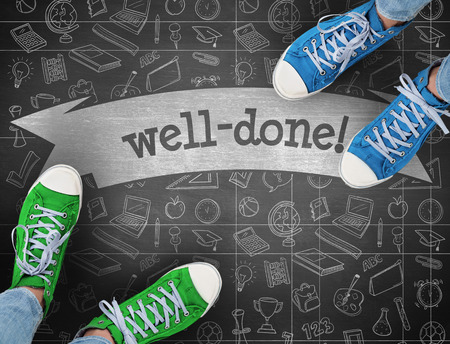 acclaim: The word well-done! and casual shoes against black background Stock Photo