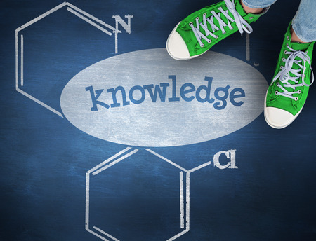 knowledge: The word knowledge and casual shoes against blue chalkboard Stock Photo
