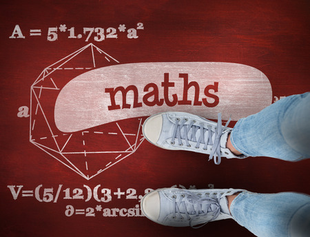 shoestring: The word maths and woman wearing trainers  against desk