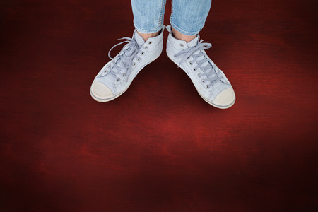 shoestring: Woman wearing trainers  against desk