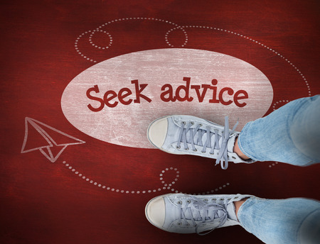 seek: The word seek advice and woman wearing trainers  against desk