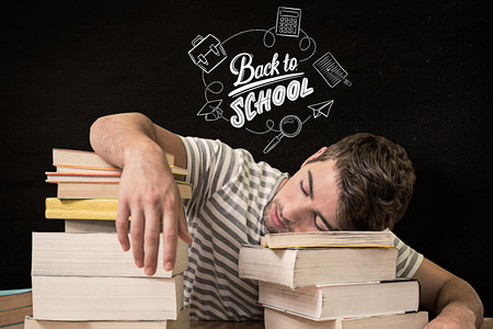 slump: Student asleep in the library against black Stock Photo