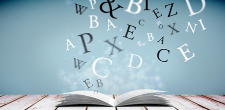 literate: letters against light design shimmering on silver Stock Photo