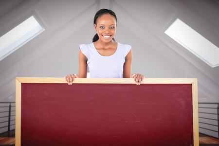 placeholder: Woman with placeholder in her hands on white background against white room with skylights