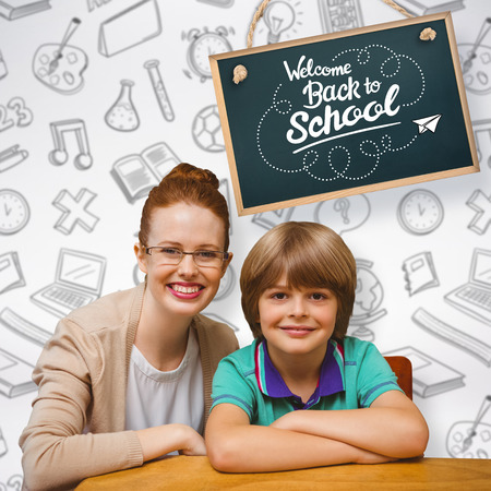 pupil: Happy pupil and teacher against grey background