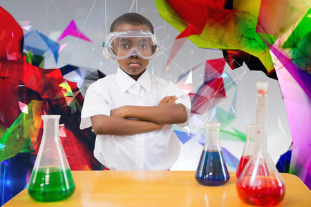 make believe: Pupil conducting science experiment against angular design
