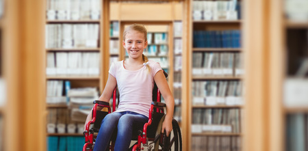 female child: Girl sitting in wheelchair in school corridor against library