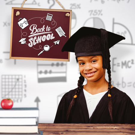 graduating: Cute pupil graduating against wooden planks background Stock Photo