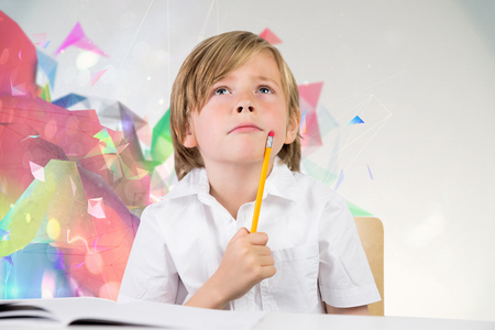 pupil: Cute pupil thinking against colourful abstract design