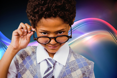 the pupil: Pupil wearing glasses against glowing abstract design Stock Photo