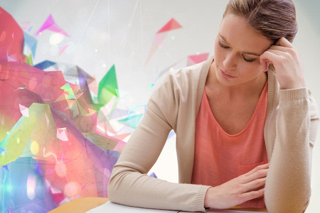 abstract academic: Student studying against colourful abstract design Stock Photo