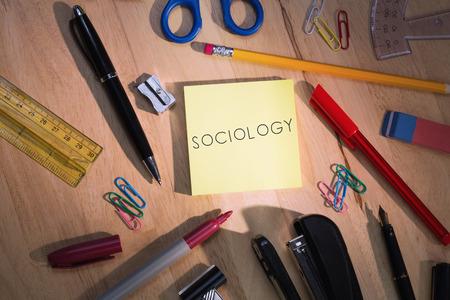 sociology: La palabra sociología contra la mesa de los estudiantes con útiles escolares Foto de archivo