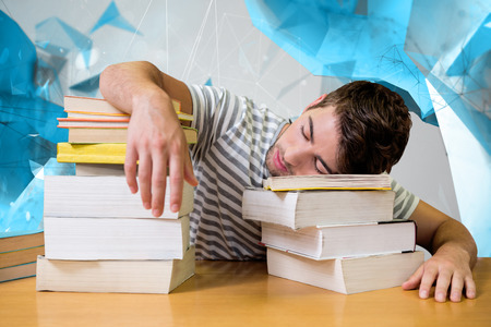 slump: Student asleep in the library against angular design