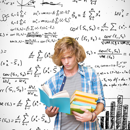 equations: Student reading against maths equations Stock Photo
