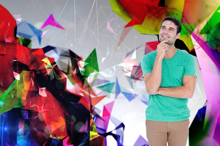 looking up: Full length of handsome man looking up against angular design Stock Photo