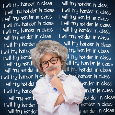 i kids: Cute pupil in lab coat  against blue chalkboard Stock Photo
